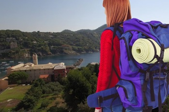 A traveler with a large bag on her back