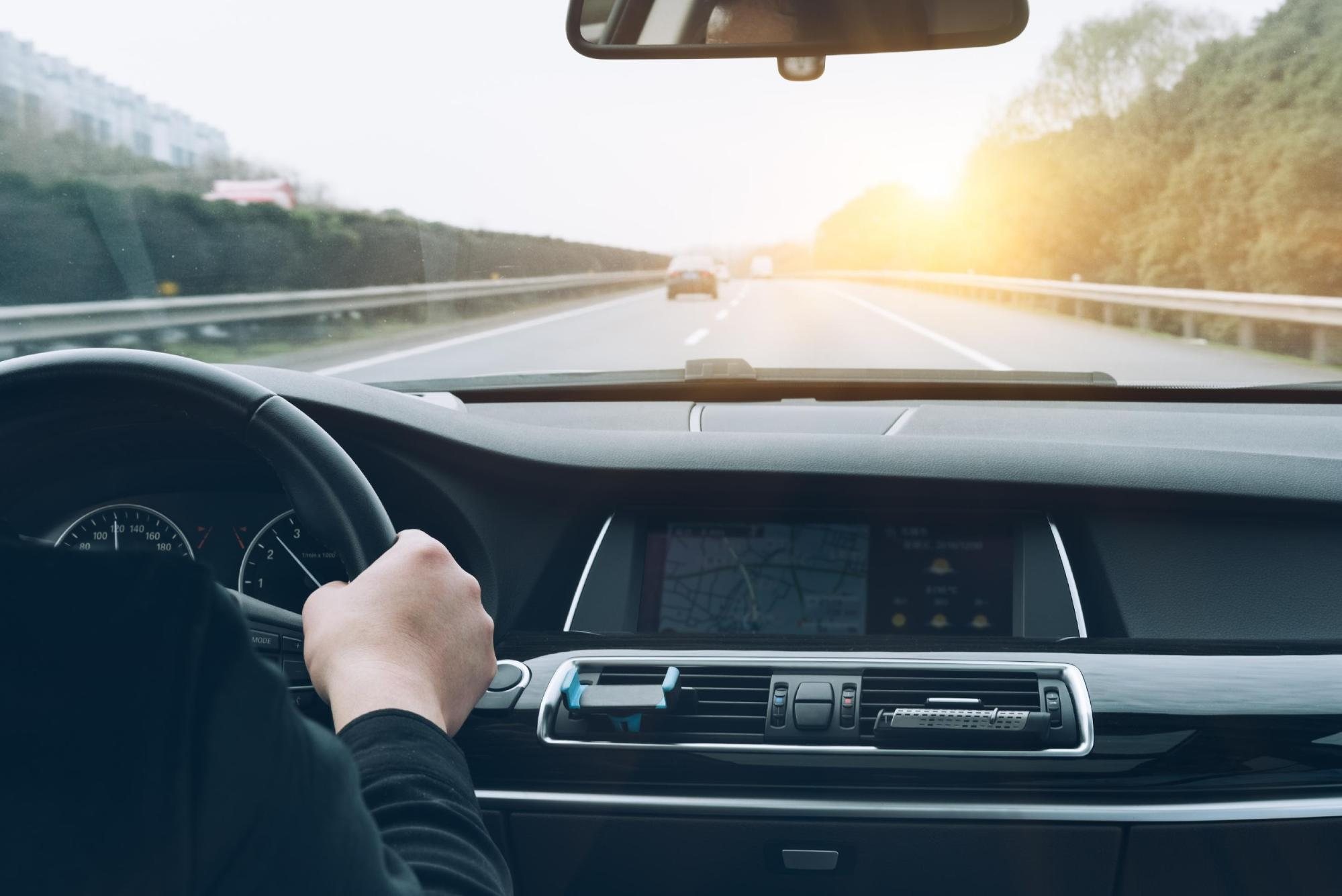 inside car view of a man driving